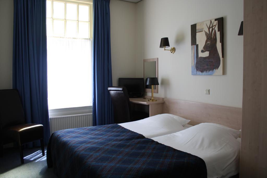 Standaard Middel kamer met 2 bedden blauw